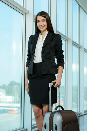 Business woman on plane tickets waiting for your flight at the airport