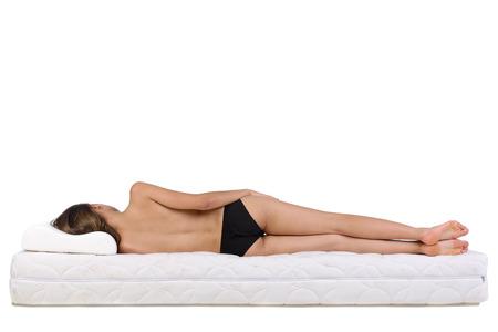 Foto de Portrait of a woman lying on a mattress. Orthopedic mattress. - Imagen libre de derechos