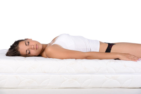 Foto de Portrait of a woman lying on a mattress. Orthopedic mattress. - Imagen libre de derechos