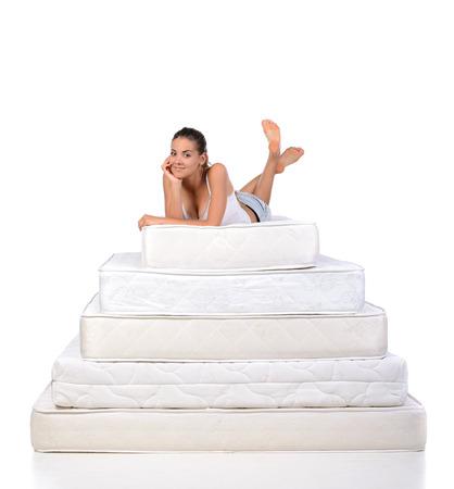 Photo pour Portrait of a woman lying on many mattresses. Orthopedic mattress. - image libre de droit