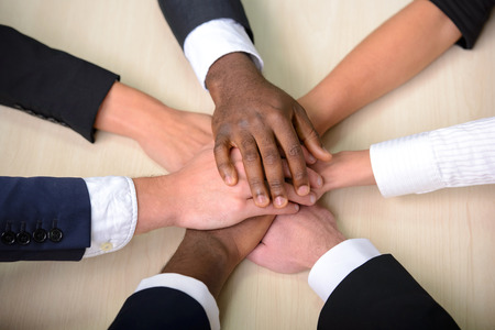 Foto de Celebrating victory. Group of business people joining hands. - Imagen libre de derechos