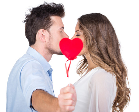 Photo pour Beautiful couple in love kissing, isolated on white  - image libre de droit