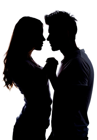 Photo pour Silhouette a happy couple holding each other - image libre de droit
