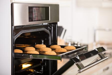 Photo pour Cookies on the grid in the oven. - image libre de droit