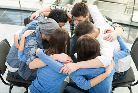 Photo pour Circle of trust. Group of people are sitting embracing in circle  and supporting each other. - image libre de droit