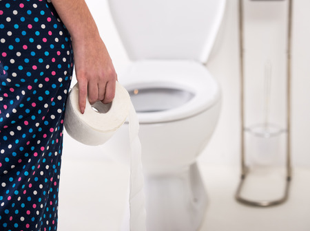 Foto de Close-up of woman on toilet in morning. - Imagen libre de derechos