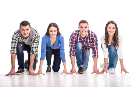 Foto de People on starting line. Group of young people are standing on starting line and are looking forward while isolated on white. - Imagen libre de derechos