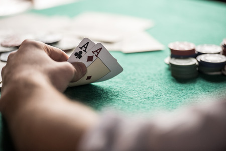 Foto de Top view of a poker table during a game. Chips, money and cards on the table. - Imagen libre de derechos