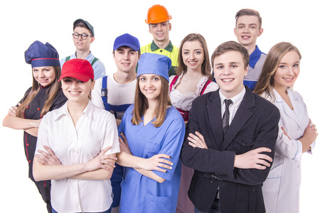 Foto de Young group of industrial workers. Isolated on white background. - Imagen libre de derechos