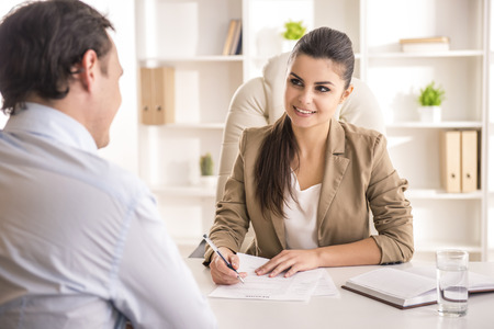 Foto de Businesswoman interviewing male candidate for job in office. - Imagen libre de derechos