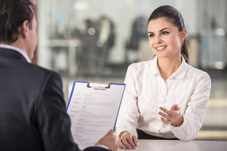 Photo for Businessman interviewing female candidate for job in office. - Royalty Free Image