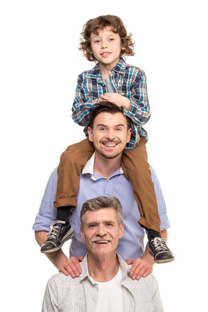 Photo pour Generation portrait. Grandfather, father and son, isolated a white background. - image libre de droit