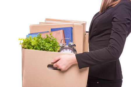 Photo for Side view. Business woman holding box with office items.  - Royalty Free Image