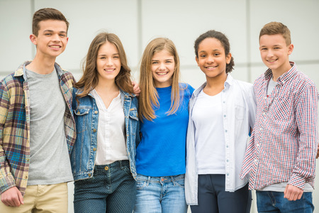 Photo for Group of smiling cheerful teenagers having fun after lessons. - Royalty Free Image