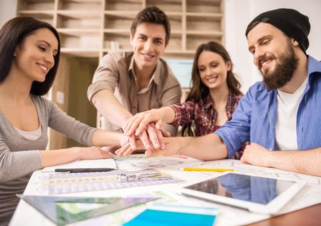 Foto de Designers meeting to discuss new ideas at office. Team work. - Imagen libre de derechos