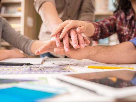 Photo for Creative group of designers putting hands together. Team work. - Royalty Free Image