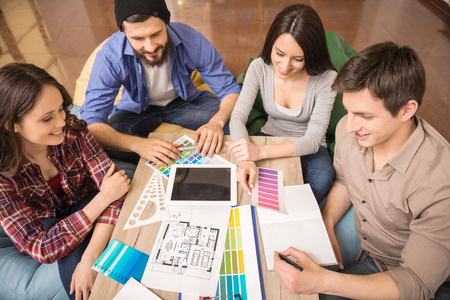 Foto de Designers meeting to discuss new ideas at office. Team work. - Imagen libre de derechos