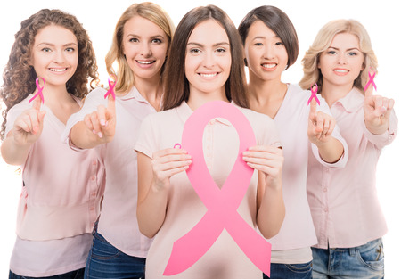 Photo pour Confident female volunteers participating in breast cancer awareness. - image libre de droit
