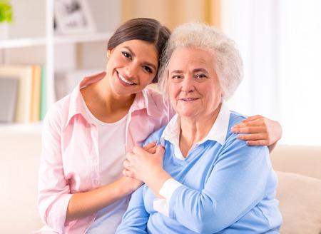 Foto de Care of senior woman at home sitting on the couch - Imagen libre de derechos