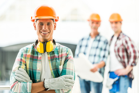 Photo pour Portrait of male engineers builder in yellow helmet in the office center - image libre de droit