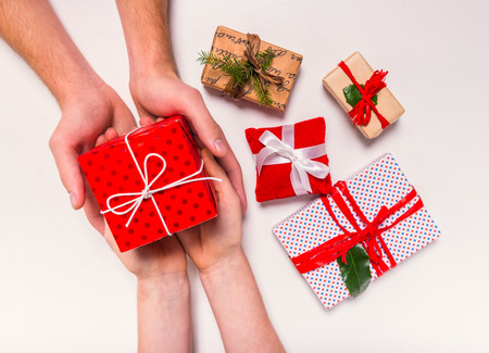 Foto de Hand holding box for a gift isolated on a white background - Imagen libre de derechos