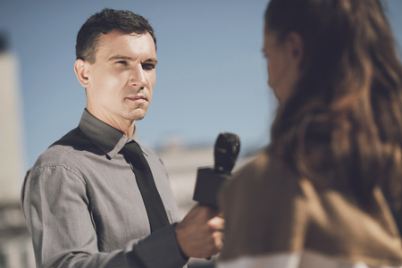 Photo for A man with a serious face interviews a woman - Royalty Free Image
