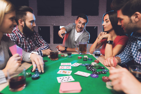 Photo for Young people play poker at the table. - Royalty Free Image