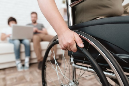 Photo pour Woman veteran in wheelchair returned from army. Close-up photo veteran woman in a wheelchair. Wheelchairs and legs in military uniform. - image libre de droit