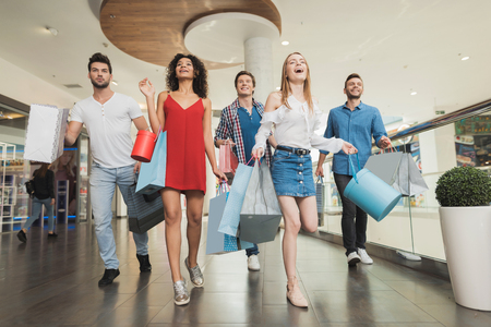 Photo for Sale in black Friday. The company of young people are engaged in shopping on a black Friday. - Royalty Free Image