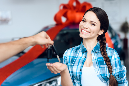 Photo for A man makes a gift - a car to his wife. - Royalty Free Image