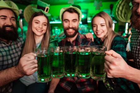 Photo for The company of young people celebrate St. Patricks Day. - Royalty Free Image