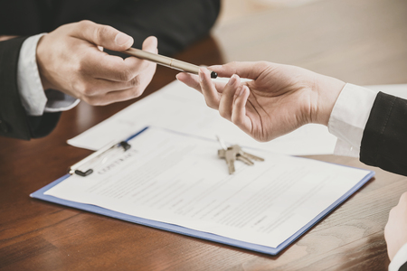 Photo for Close-up of hands with a pen to signing a contract. - Royalty Free Image