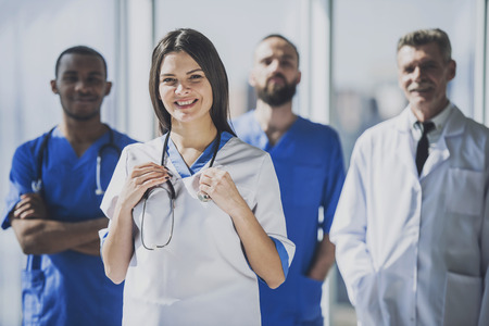 Foto de Professional Doctor with Stethoscope in White Uniform Standing in Hospital. Doctors with Medical Equipment at Background. Healthcare Professionals and Medical Staff Concepts. Modern Clinic Concept. - Imagen libre de derechos