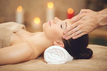 Foto de Smiling Woman Getting Massage in Health Spa. Spa Concept. - Imagen libre de derechos