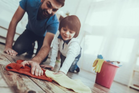 Photo for Happy Together. Cleanliness. Smile. Have Fun. Clean House Together. Family. Holidays.Two Boys. Father. Baby with Bright Hair. Smiling Kid. Spends Time. Home Time. Father Two Boys. Leisure Time. Man. - Royalty Free Image