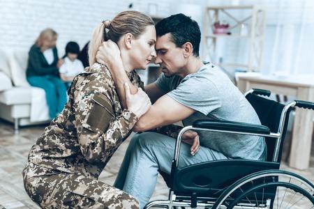 Foto de A Woman In Camouflage Goes To Military Service. - Imagen libre de derechos