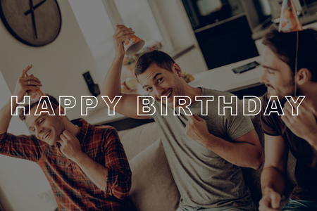 Photo for Happy Birthday Celebration. Guys Prepare Party. Friends Sit on Couch. Men Put On Birthday Hats. Best Friends Forever. Friends Happy Together. Men Having Fun. Guys Spend Time Together. Cheerful Guys. - Royalty Free Image