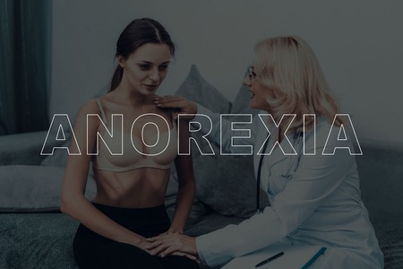 Foto per Woman With Anorexia. Consultation With Doctor. Weight Loss. - Immagine Royalty Free