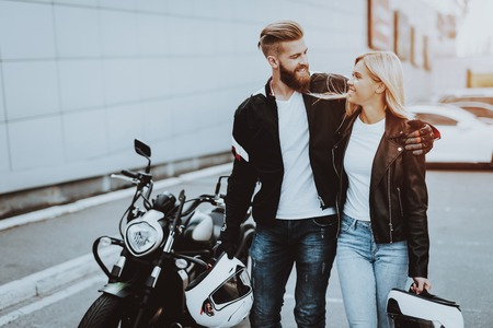 Photo for Man And Women Bikers With Helmet. Motorbike Concept. Ready To Ride. Classic Style. Tripping Together. Street Vehicle. Journey Transport. Riders Couple. Jeans And Jackets. Sunny Day. - Royalty Free Image