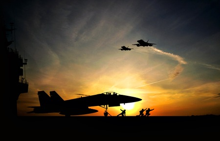 Foto de Military aircraft before take-off from aircraft carrier on dramatic sunset  - Imagen libre de derechos