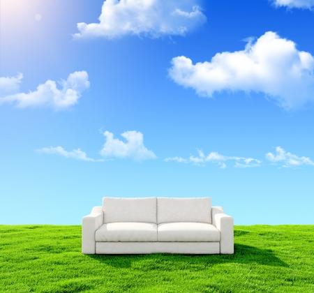Photo pour White sofa on a green field against the blue sky - image libre de droit