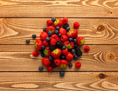 Photo for Berries on Wooden Background. - Royalty Free Image