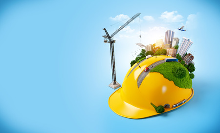 Foto de City on the construction helmet.  - Imagen libre de derechos