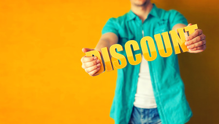 Photo for Man holds word Discount on bright colorful background - Royalty Free Image