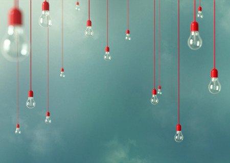 Foto de Photo of Hanging light bulbs with depth of field. Modern art - Imagen libre de derechos