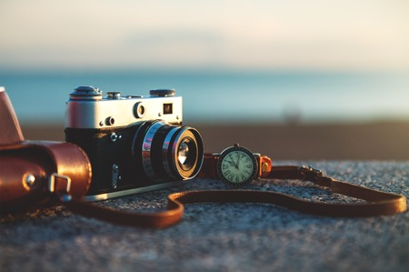 Photo for Photo of vintage camera at sunset in park - Royalty Free Image