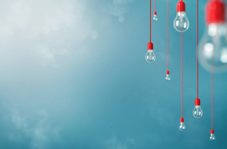 Photo pour Photo of Hanging light bulbs with depth of field. Modern art - image libre de droit