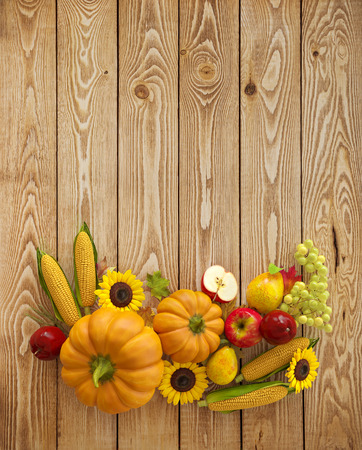 Autumn Thanksgiving Day composition fruits and vegetables on wooden background. Unusual thanksgiving day illustration. Top view