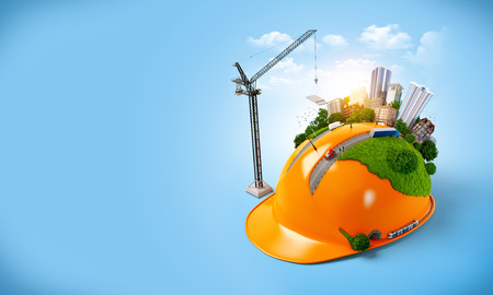 Foto für City on the construction helmet. Unusual construction concept - Lizenzfreies Bild