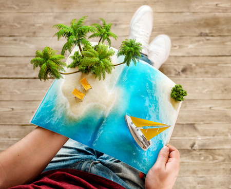 Foto de Tropical island with palms and deck chairs on a page of opened magazine in hands. Unusual travel 3d illustration. Summer travel and vacation concept - Imagen libre de derechos
